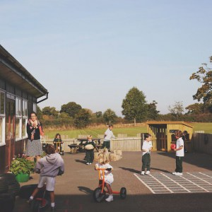 Preparing for Preschool: Children playing together in a sunny playground