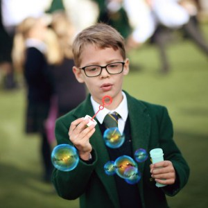 Mindful Parenting: A little boy blowing bubbles into the air
