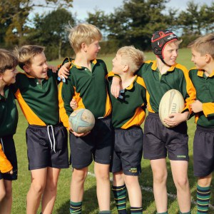 Boys holding rugby boys