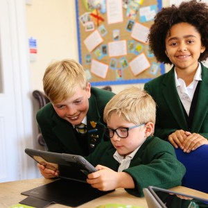 St Peter's Prep pupils looking at YouTube videos