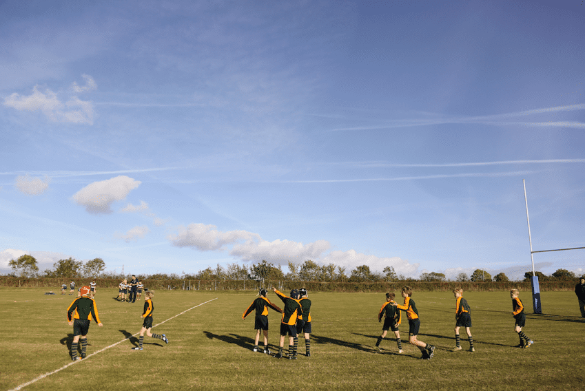 team playing rugby sport