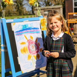a picture of a girl with a sun drawing
