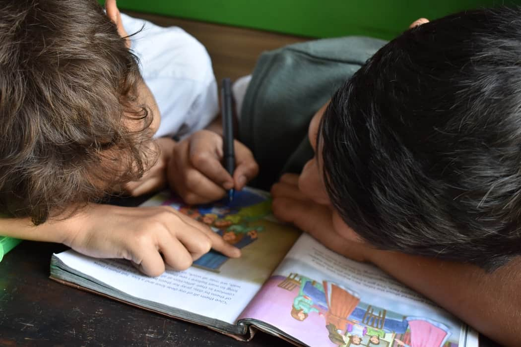 Children colouring in a book