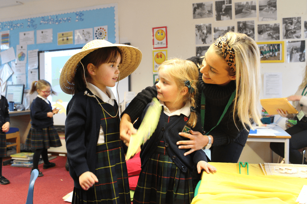 A teacher helping the girls get ready for China day.