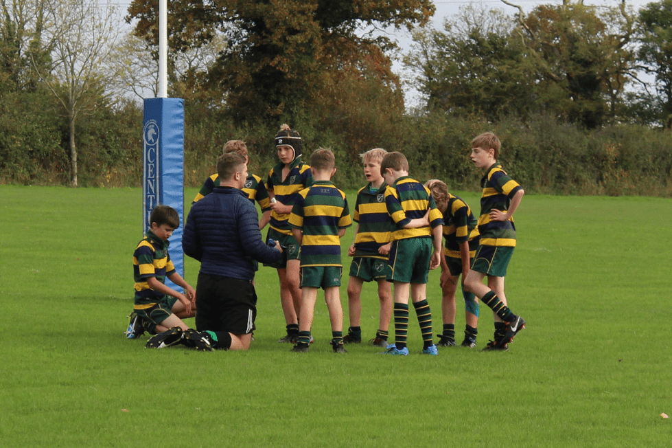 A coach reassures and motivates a rugby team