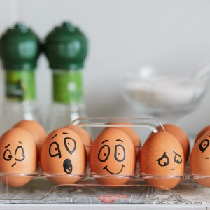 Faces painted on eggs displaying a range of emotions.