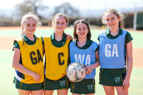 Young girl learning netball at St Peter's Prep School