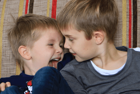 Two young brothers looking at each other