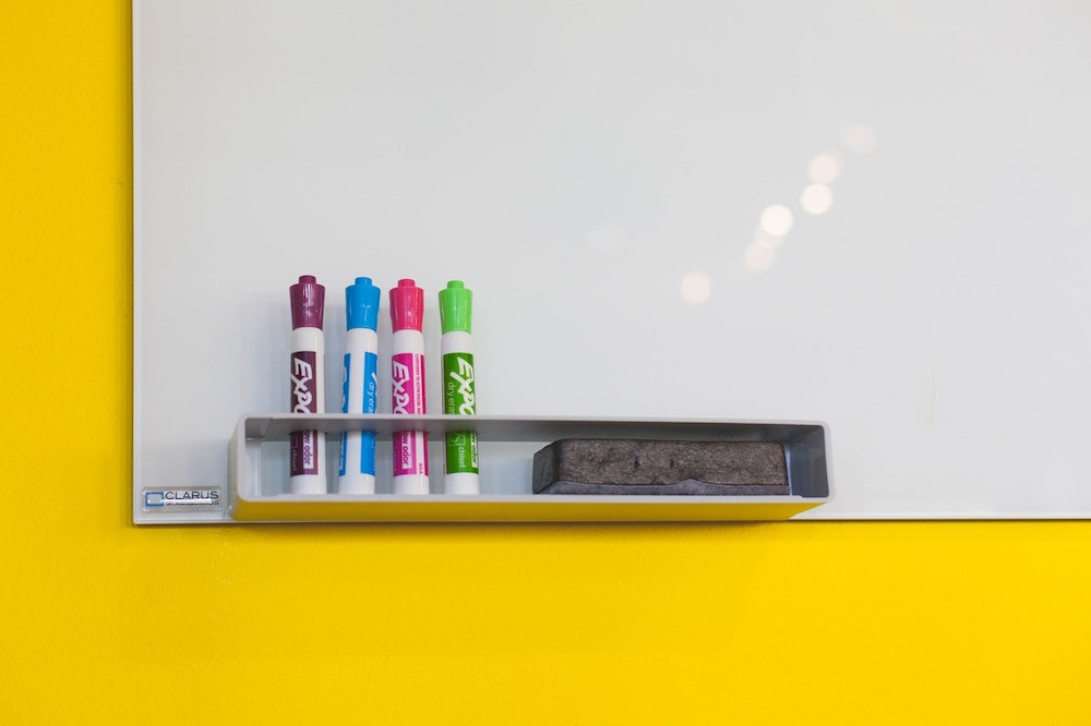 A whiteboard and colourful pens