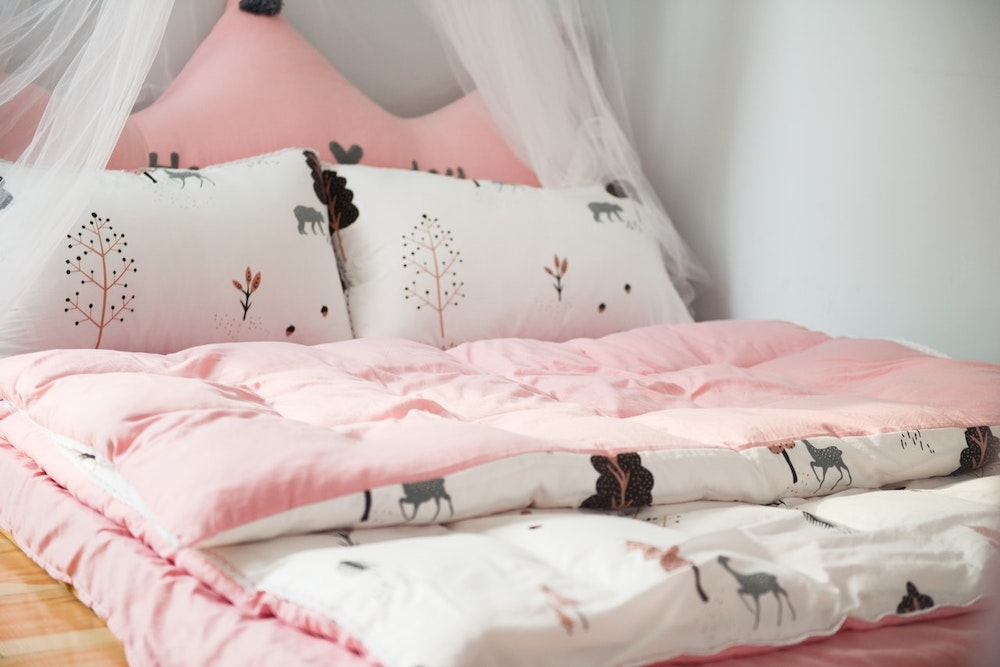 A pink and white bed