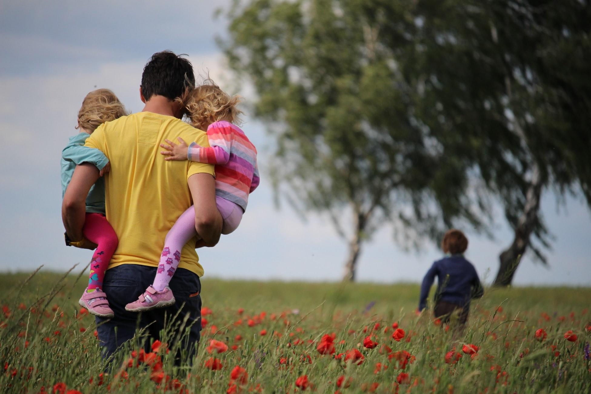 a family walking in a field